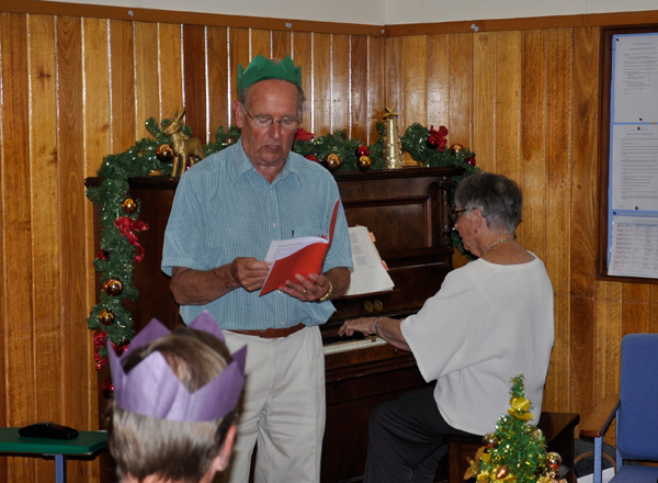 Geoff Hinde and Jeanette Barklamb lead Carols at the Christmas Dinner
